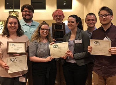 Eastern Progress staff show off awards earned at the 150th annual KPA Convention