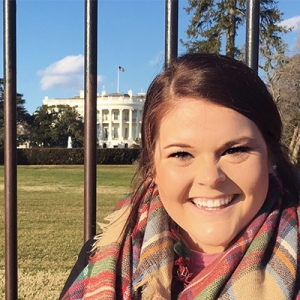Rachel Knoebel stands outside the gate to the White House