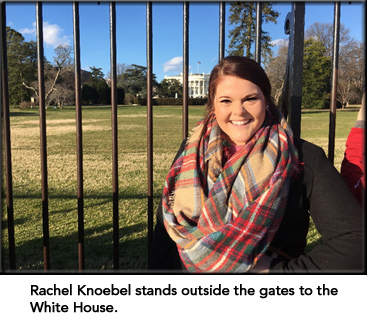 Rachel Knoebel stands outside the gates of the White House